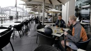 Australians can now dine out, after lockdown restrictions were eased (Rick Rycroft/AP)