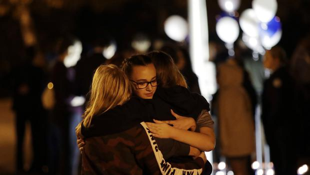 Students embrace during a vigil in the aftermath of the shooting at Saugus High School (Marcio Jose Sanchez/AP)