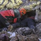 Rescue workers try to save people trapped in Elazig (Ismail Coskun/IHA via AP/PA)