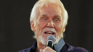 Kenny Rogers has died aged 81 (PA)