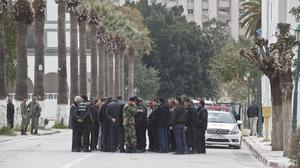 Tunisian police and defence officials gather outside the National Bardo museum in Tunis