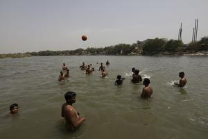 Indian youth cool off in the River Yamuna in New Delhi, India (Manish Swarup/AP)