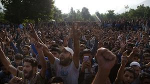 Kashmiri villagers shout during the funeral procession of Burhan Wani, chief of operations of Indian Kashmir's largest rebel group Hizbul Mujahideen, in Tral (AP)