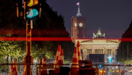 Traffic lights at the road leading to the Brandenburg Gate in Berlin (Michael Probst/AP)