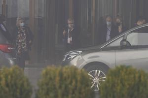 Members of the WHO team leave their hotel on Wednesday morning (Ng Han Guan/AP)