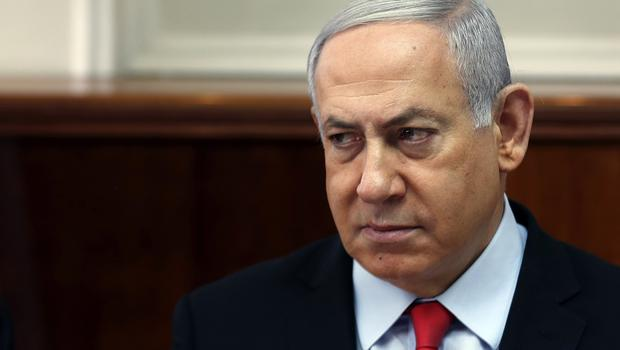 The decision will have a major impact on Mr Netanyahu's chances of staying in office (Ronen Zvulun/Pool/AP)