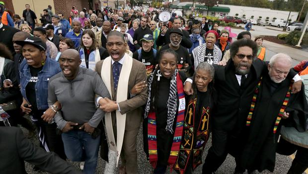 A march in Ferguson to protest against the shooting of Michael Brown (AP)