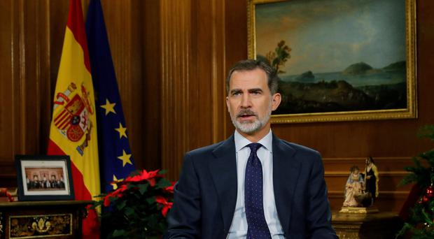 Spain's King Felipe VI delivers his traditional annual Christmas speech from the Zarzuela Palace in Madrid, Spain (Ballesteros/AP)