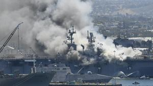 Smoke rises from the USS Bonhomme Richard at Naval Base San Diego (Denis Poroy/AP)