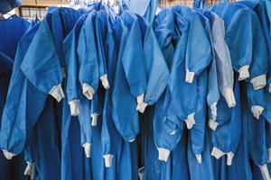 PPE equipment hangs outside tents where Covid-19 patients are being treated at the Tshwane District Hospital in Pretoria (Jerome Delay/PA)