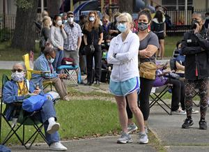 Voters wait in a long line in New Orleans on Friday (Max Becherer/The Advocate/AP)