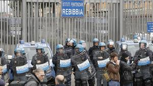 Police stand in front of the entrance of Rebibbia prison (Andrew Medichini/AP)