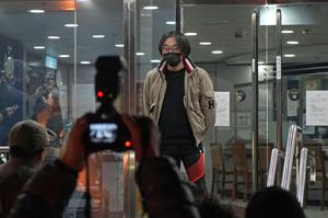 Mike Lam King-nam, who participated in the pro-democracy primary elections, walks out at a police station after being bailed out in Hong Kong, on Thursday (Kin Cheung/AP)