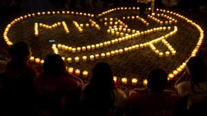 Relatives of Chinese passengers on board Malaysia Airlines Flight 370 hold a candlelight vigil for their loved ones in Beijing (AP Photo/Andy Wong, File)