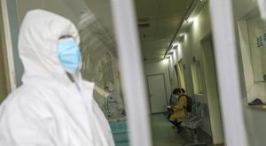 Medical workers in protective gear (Chinatopix via AP)