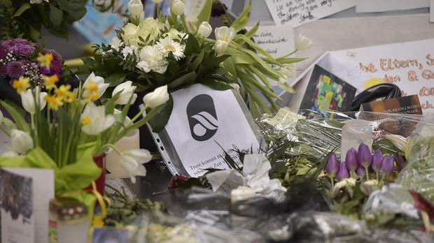 A Germanwings logo amid flowers and messages for the victims of the Alps plane crash. (AP)