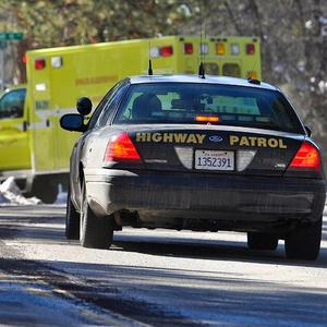 Law enforcement officials respond after fugitive Christopher Dorner engaged in a shootout that wounded two officers (AP/The Sun, Rachel Luna)
