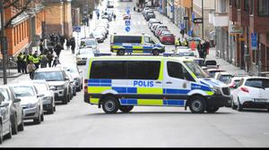Police vans block the street outside Stockholm District Court as 39-year-old Uzbekistan national Rakhmat Akilov appears at a remand hearing. (Fredrik Sandberg/TT/AP)