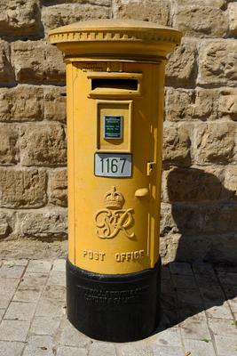 A yellow painted Post Office post box in Nicosia, Cyprus (Andrew Matthews/PA)