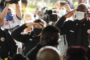 Texas Southern University police salute as family and guests arrive for George Floyd's funeral (AP/Eric Gay)