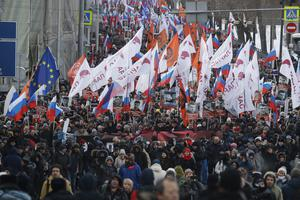 People march in memory of opposition leader Boris Nemtsov in Moscow (Pavel Golovkin/AP)