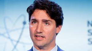 Canadian prime minister Justin Trudeau was applauded as he explained about quantum computing (AP)