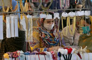 Women in Islamabad, Pakistan browse jewellery in preparation for the upcoming Eid al-Fitr holiday (Anjum Naveed/AP)