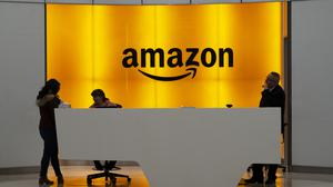 Amazon says it needs 100,000 more workers to cope with demand as people stay home and shop online due to the coronavirus (Mark Lennihan/AP)
