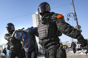 Police officers detain a man during a protest against the jailing of opposition leader Alexei Navalny in Vladivostok (Aleksander Khitrov/AP)