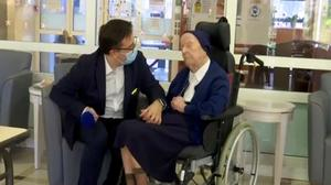 Sister Andre, born Lucile Randon, is interviewed by David Tavella, communications manager for the Sainte Catherine Laboure Nursing Home in Toulon, France, after surviving coronavirus at the age of 116 (BFM TV/AP)