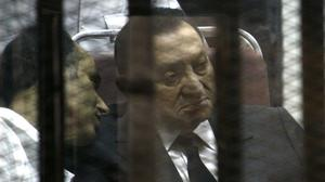 Hosni Mubarak sits in the defendants' cage behind protective glass during a court hearing (AP)