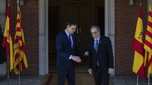 Spanish Prime Minister Pedro Sanchez, left, welcomes Catalan regional President Quim Torra at the Moncloa palace in Madrid (Bernat Armangue/AP)
