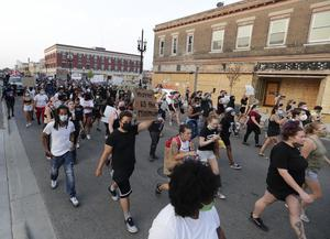 Protesters march in Kenosha in response to the shooting of Jacob Blake (Rick Wood/Milwaukee Journal-Sentinel via AP)