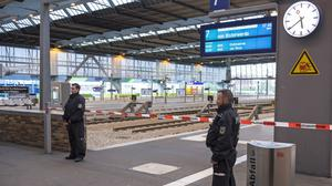 Police officers patrol the Central Station in the eastern city of Chemnitz, Germany (AP)