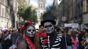 A costumed couple during the Day of the Dead parade in Mexico City (AP)