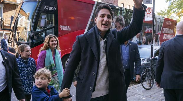 Canadian Prime Minister and Liberal leader Justin Trudeau arrives at a poling station with his son Hadrian, his wife Sophie and daughter Ella-Grace in Montreal (Paul Chiasson/The Canadian Press/AP)