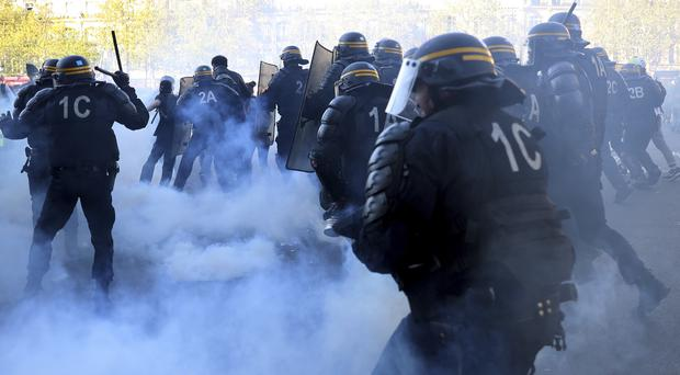 Police scuffle with protesters (Francisco Seco/AP)