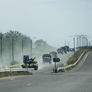Pro-Russian troops in tanks, armoured vehicles and trucks drive towards Donetsk (AP)