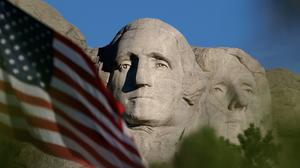 US President Donald Trump is planning to kick off Independence Day weekend in South Dakota (Laura Rauch/AP)