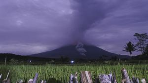 Volcanic materials spew from the crater of Mount Semeru (AP)