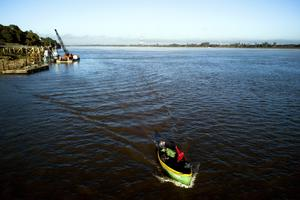 Fisherman leave the dock in a boat named Two Brothers on the Paraguay River in Asuncion, Paraguay (Jorge Saenz/AP)