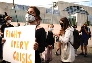 Climate activists Greta Thunberg, centre, and Luisa Neubauer, front right, arrive for a meeting with German Chancellor Angela Merkel in Berlin (Kay Nietfeld/dpa via AP)