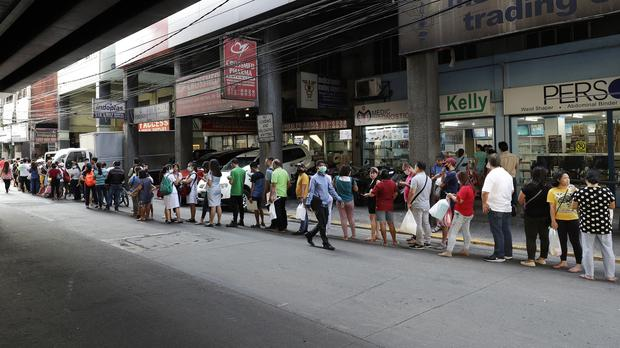 People queuing to buy protective face masks in Manila, Philippines (AP/Aaron Favila, File)