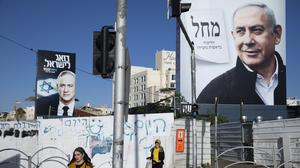 The deal between Benjamin Netanyahu's Likud Party and former military chief Benny Gantz's Blue and White ends months of political paralysis (Oded Balilty/AP)
