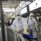 The three people had travelled to China, France's health minister said (Ahn Young-joon/AP)