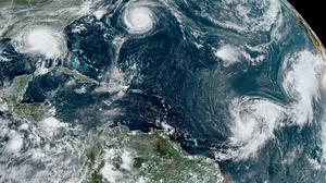 This satellite image shows five tropical hurricanes churning in the Atlantic on Monday afternoon (NOAA/AP)