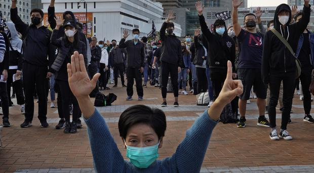 Protesters highlight five demands during a rally in Hong Kong (Vincent Yu/AP/PA)