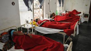 Indian women who underwent sterilisation operations receive treatment at the District Hospital in Bilaspur, in the central Indian state of Chhattisgarh (AP Photo)