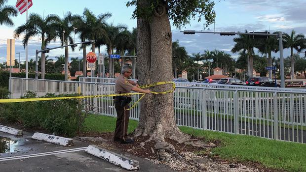 Police tape off an area by the Trump National Doral resort