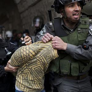 A Palestinian man is detained by Israeli security forces in Jerusalem's Old City (AP)